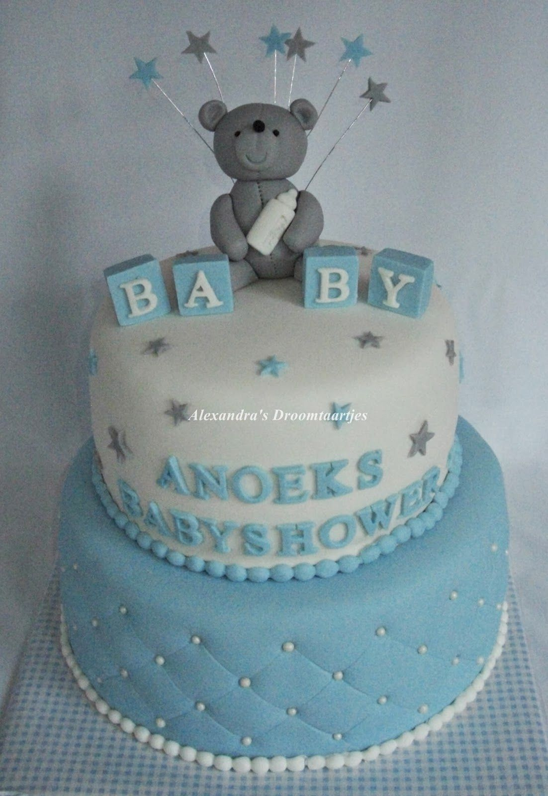 Baby Boy Babyshower Cake With A Teddy Bear On Top And