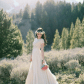 Modest wedding dress with beaded bodice and flowy skirt from alta