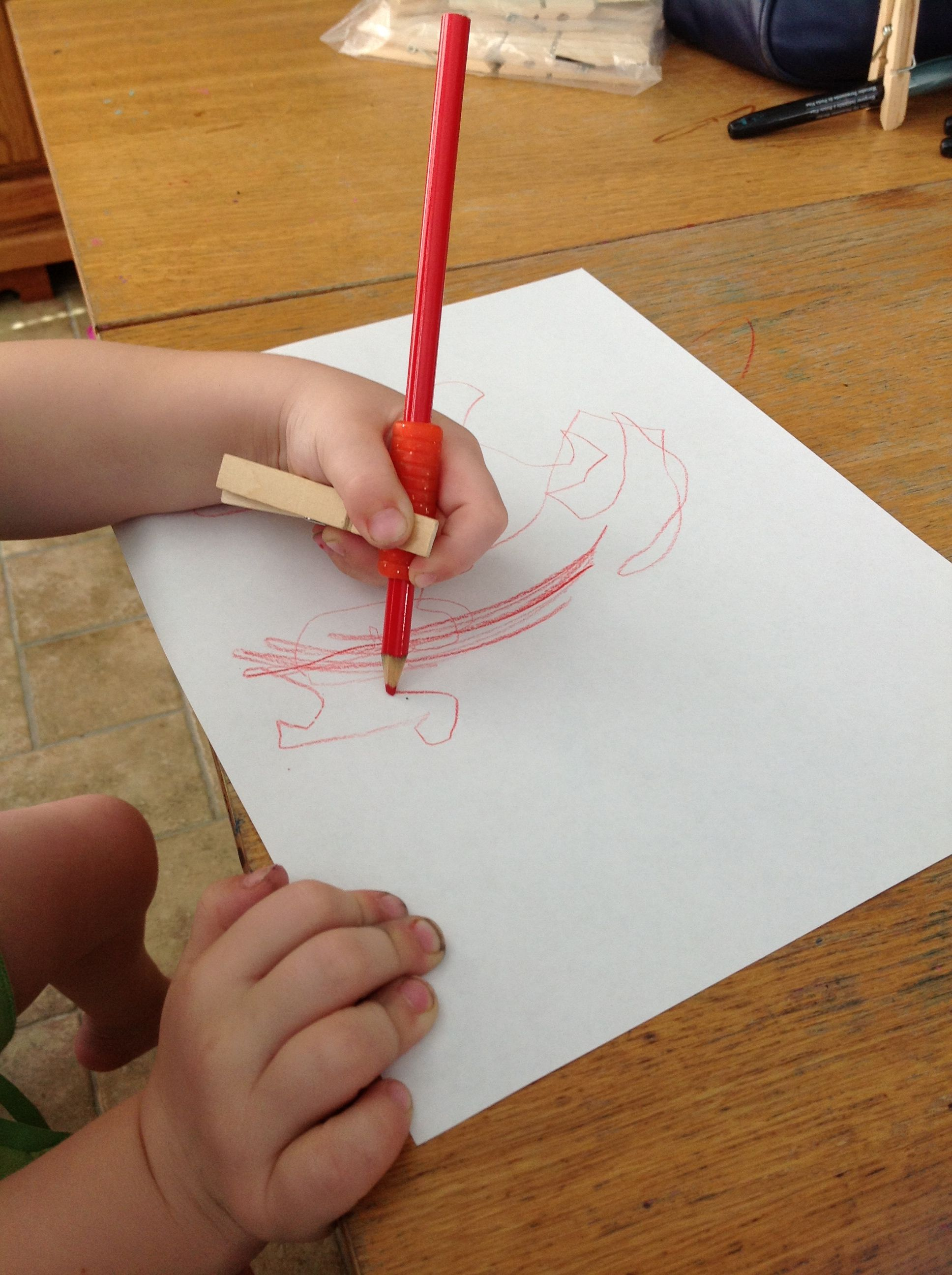 Clothespin Pencil Grip Using A Rubber Pencil Grip To