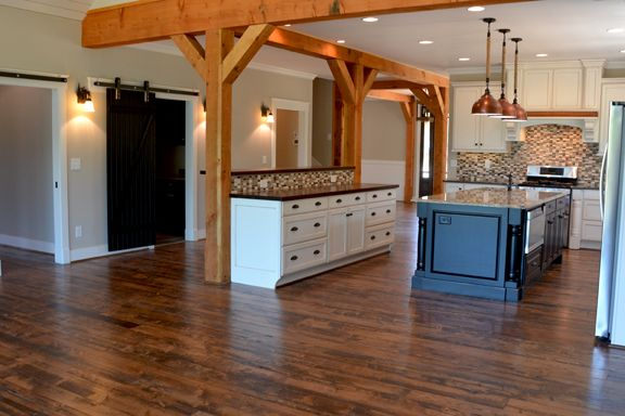 Open Concept Kitchen With Cedar Posts White Distressed