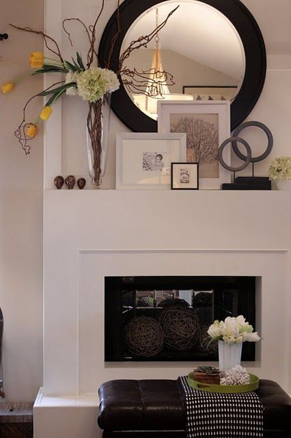 Love this simple fireplace and layering on the mantel.
