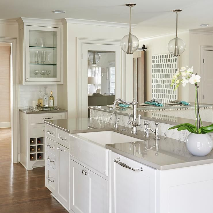 beautiful kitchen features a white kitchen island topped with gray quartz fitted with a on kitchen island ideas white quartz id=96504
