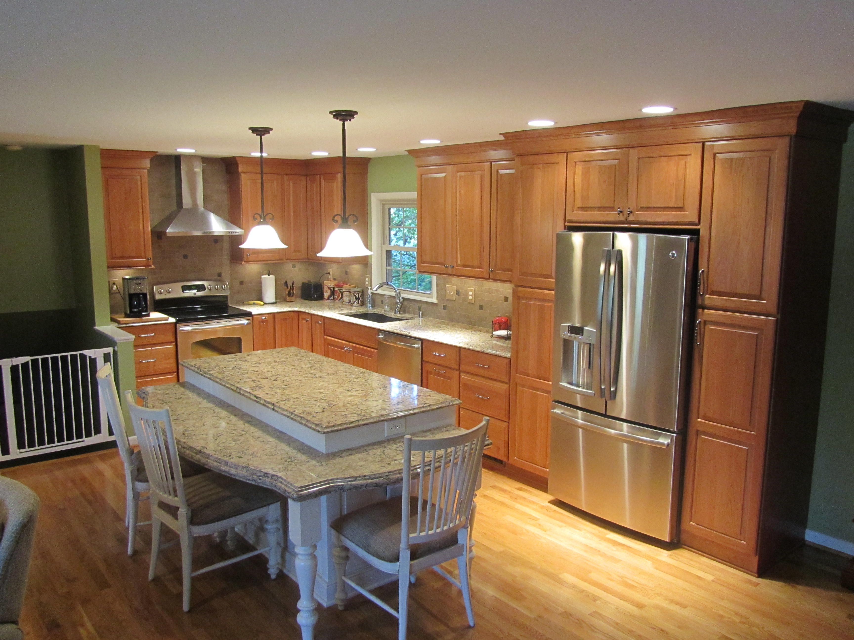 Shiloh cabinetry. Perimeter cabinets are Cherry in a ... on Natural Maple Maple Cabinets With Quartz Countertops  id=38325