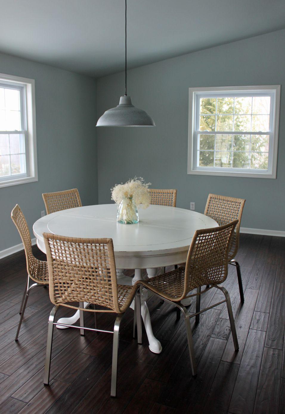 Ikea Nandor Chair With White Table On Dark Wood Floor