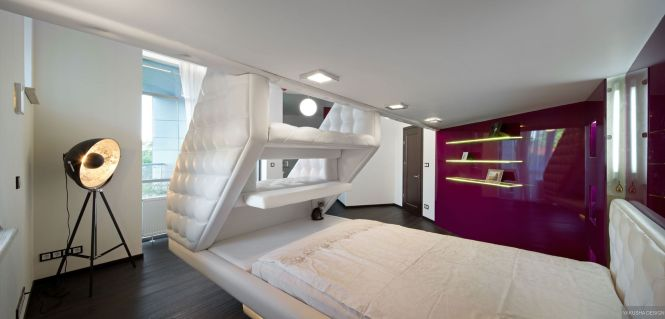 Split Level Plush Futuristic Retro Bedroom In White With Red Feature Wall And Tripod Spot Lamp Master Designbedroom
