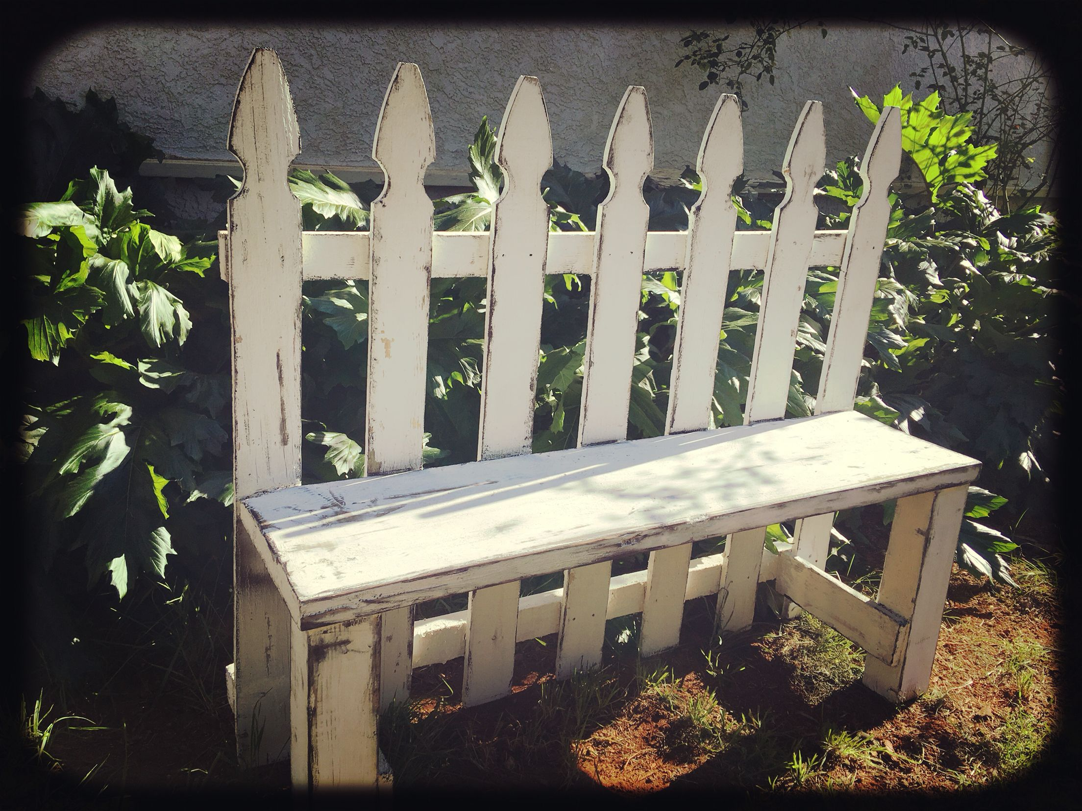 Gorgeous Upcycled Distressed White Picket Fence Garden Bench from Angry Wood Design. Measuring 46 Long and 36 tall with a seat