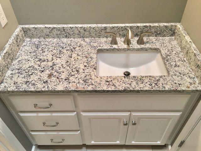 """Ashen white granite countertops Moen 8"""" widespread faucet Proflo"""