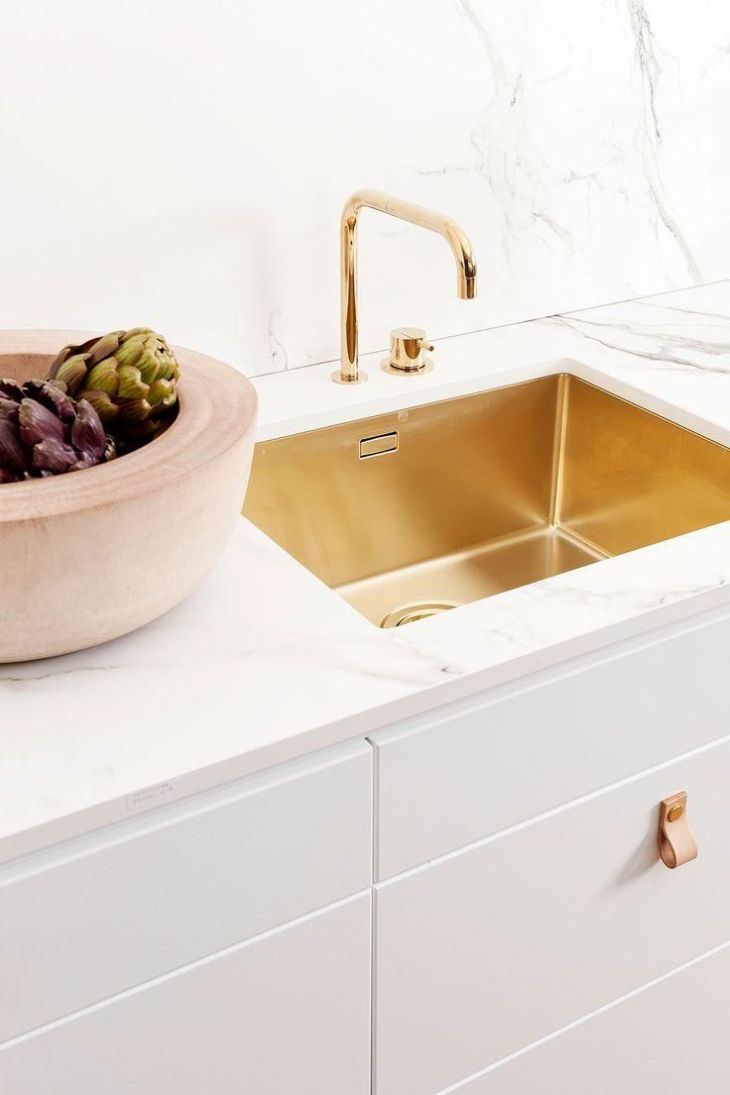 Gilded sink and marble countertop Stunning and modern  Room