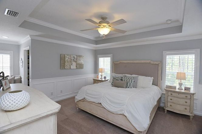 Traditional Master Bedroom With Wainscoting Demarlos Arched Top Panel Bed Crown Molding Carpet