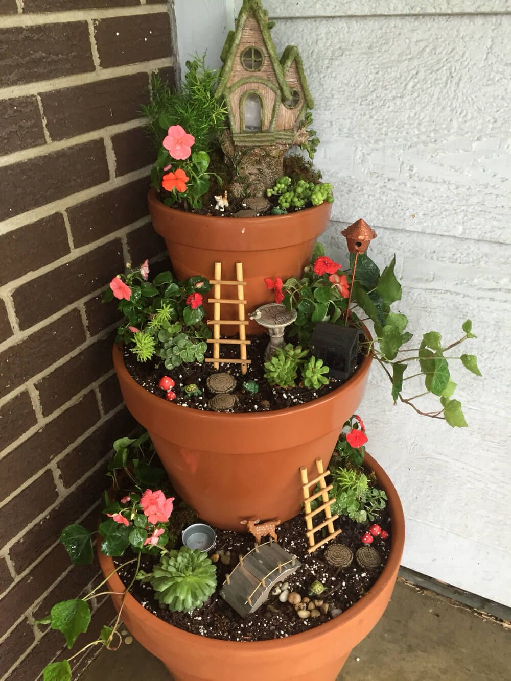 Get your kids to help you freshen up your curb appeal with this craft idea for a Tiered Front Porch Fairy Garden! By adding