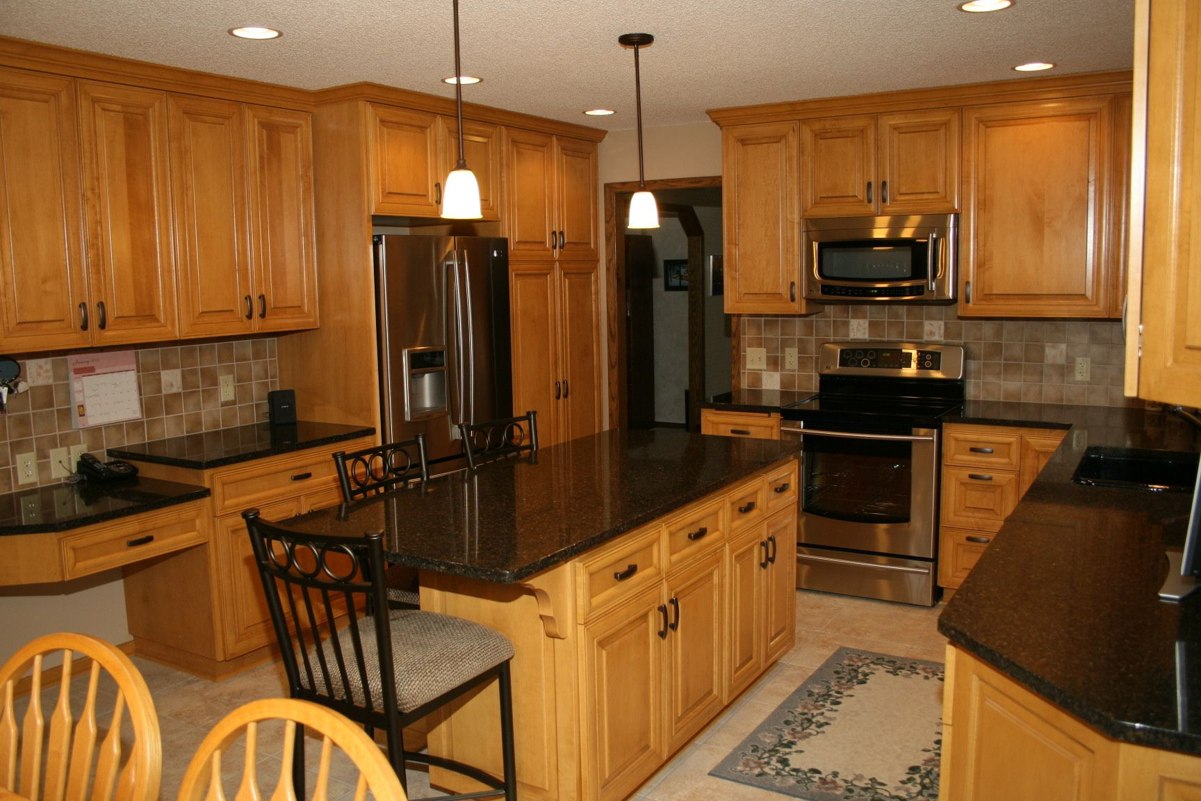 dark counters with wood cabinets   Kitchen Countertop ... on Backsplash Maple Cabinets With Black Countertops  id=97668