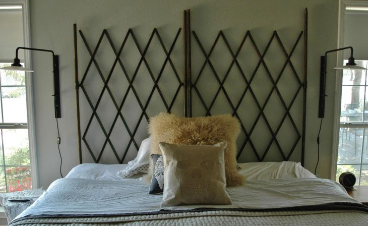 Old elevator gates as headboard Love the faux fur pillow to soften