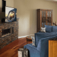 Stunning living room featuring a brick fireplace the transcend pull