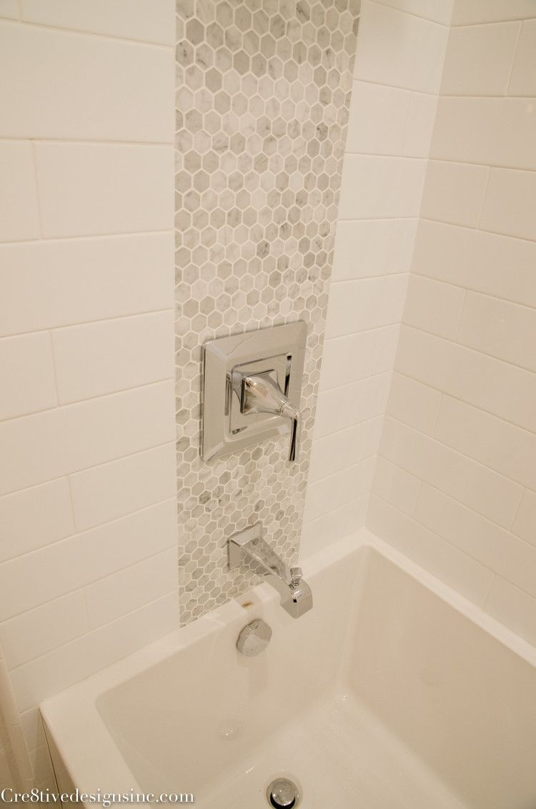 Using Accent Tiles To Tie The Plumbing Fixtures Together