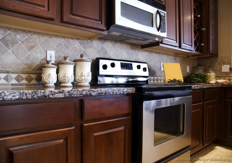 Cherry Kitchen Cabinets With Gray Wall And Quartz ... on Backsplash Ideas For Black Granite Countertops And Cherry Cabinets  id=41147