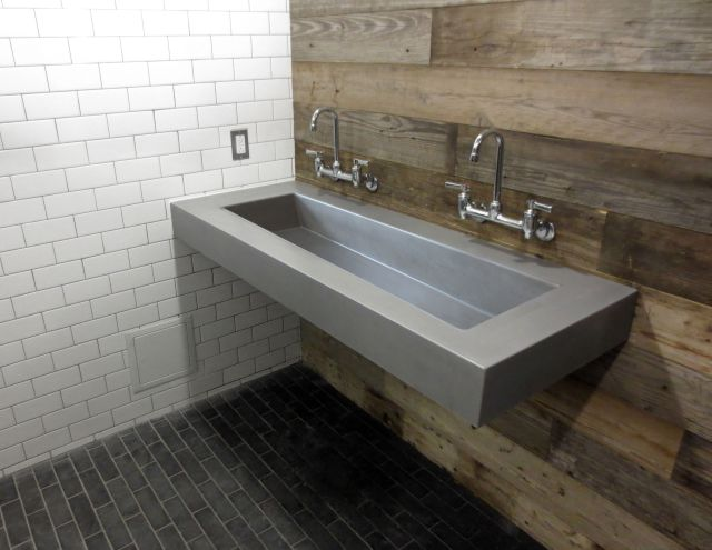 Custom Floating wall mount concrete sink by Trueform Concrete