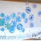 Winter bulletin board idea made with painted coffee filter snow