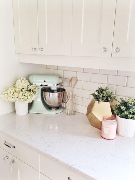 creamy white shaker style kitchen cabinets, subway tile back splash, crystal knobs