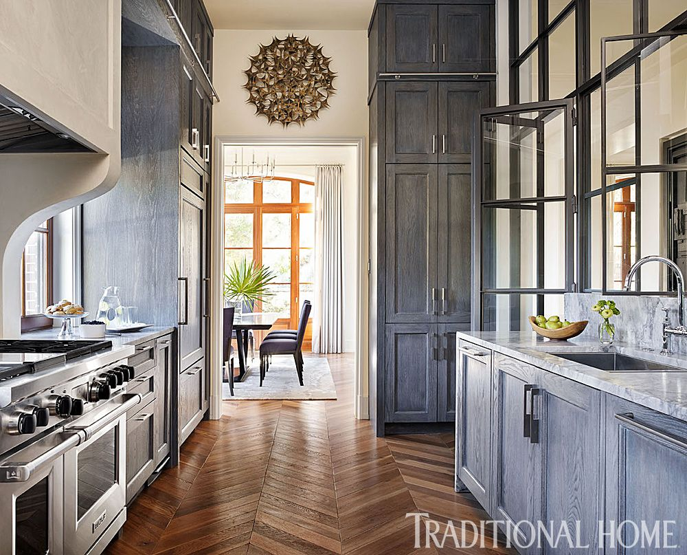 Lime Washed Oak Cabinets Extend To The Ceiling To Maximize