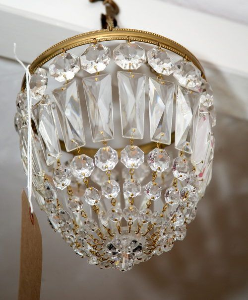 A Beautiful Small Chandelier With Lots Of Sparkle