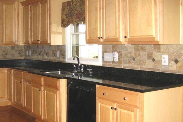 granite countertops with tile backsplash : Granite ... on Backsplash Maple Cabinets With Black Countertops  id=58714