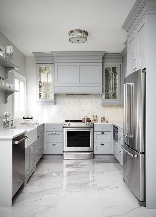 this gray u shaped kitchen features a gray paneled hood flanked by antiqued mirrored kitchen on kitchen ideas white and grey id=98396