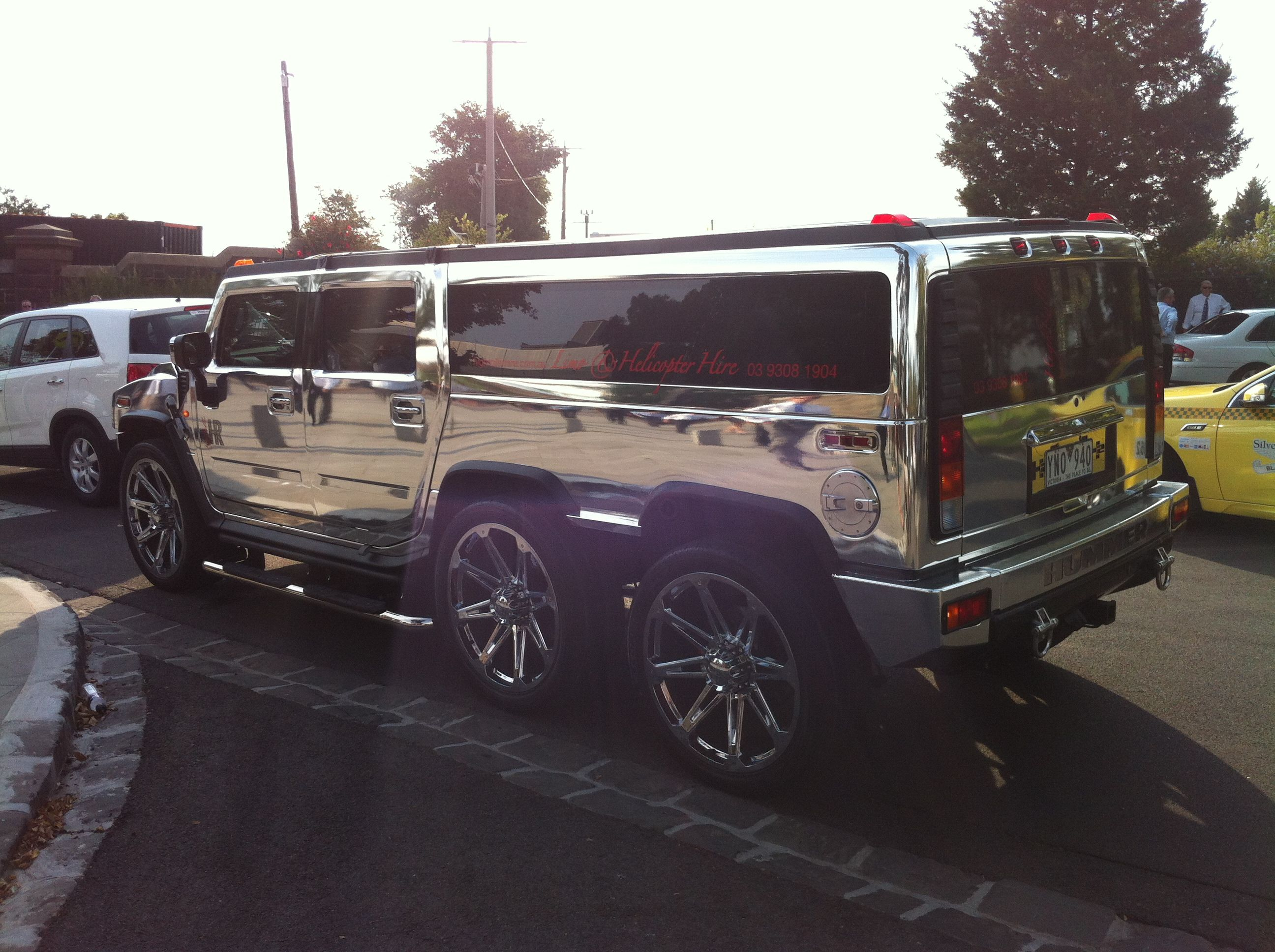 Chrome hummer limo Wedding limos SUV transportation for bride