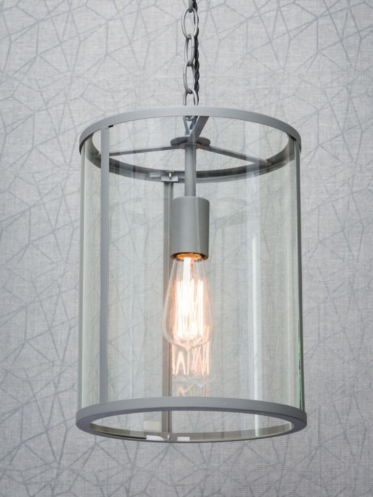 Single cylindrical industrial ceiling pendant light in a charcoal