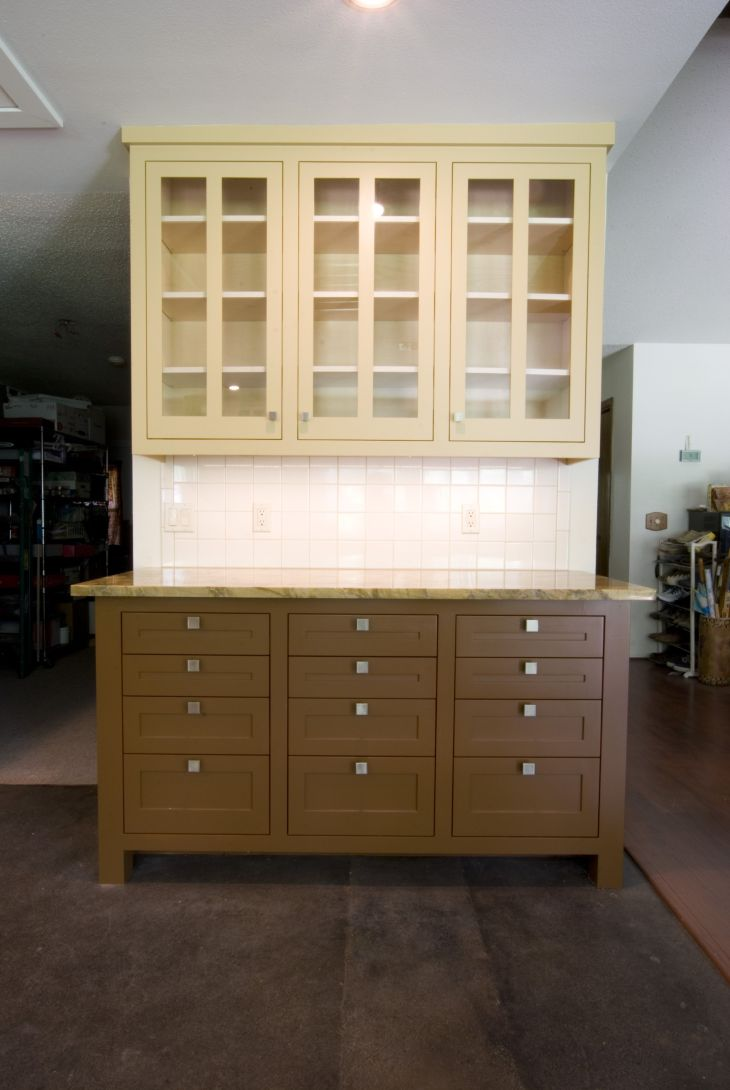 Craftsman style custom kitchen cabinets with window uppers  By