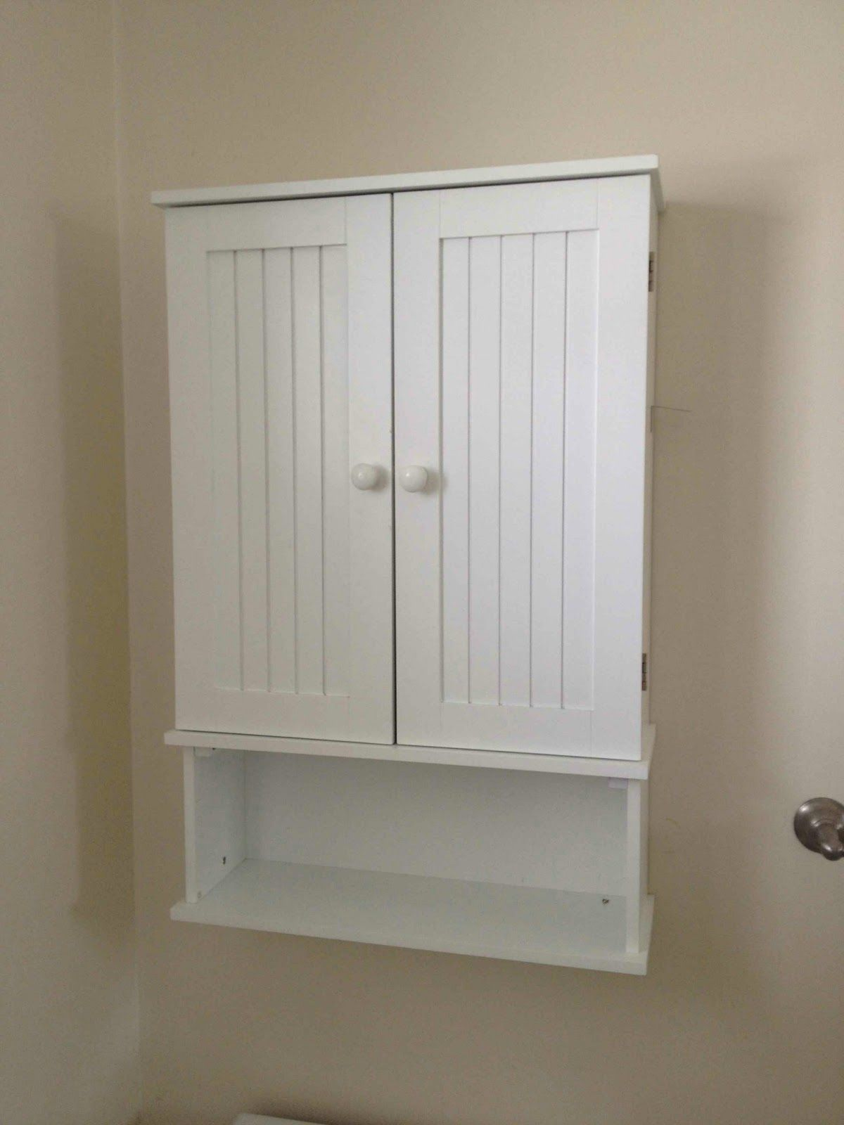amazing white wooden double door and single shelves wall mount