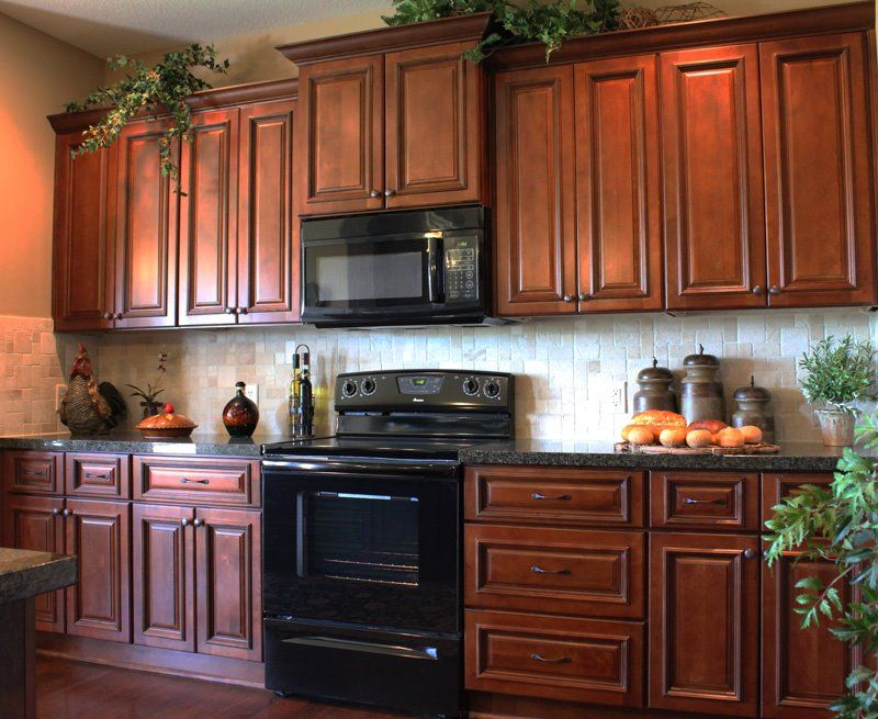 Galley kitchen with staggered heights in a rich cherry ... on What Color Backsplash With Maple Cabinets  id=61075