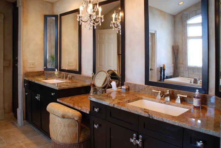 Glamour bath with granite countertops and custom cabinetry Luxury