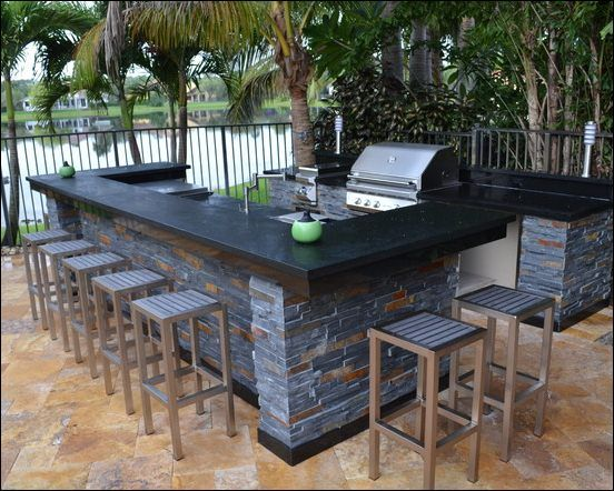 outdoor shade trees round modern outdoor kitchen design that using black countertop in concrete on outdoor kitchen natural id=42903