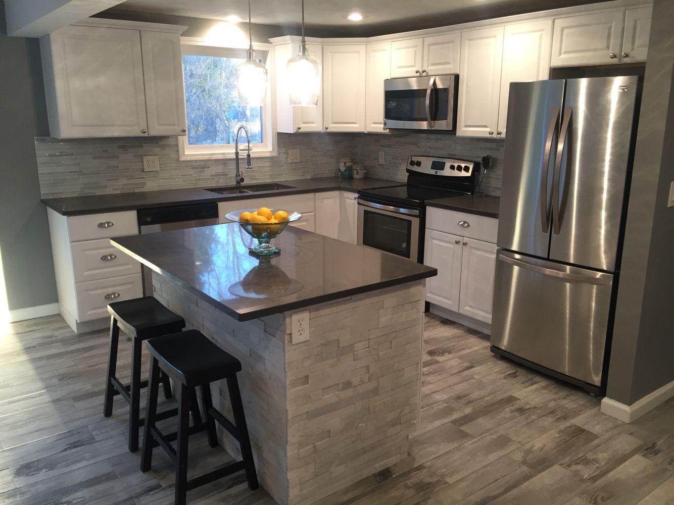 modern kitchen gleaming white cabinetry quartz counter top stainless steel appliances on kitchen island ideas white quartz id=35608
