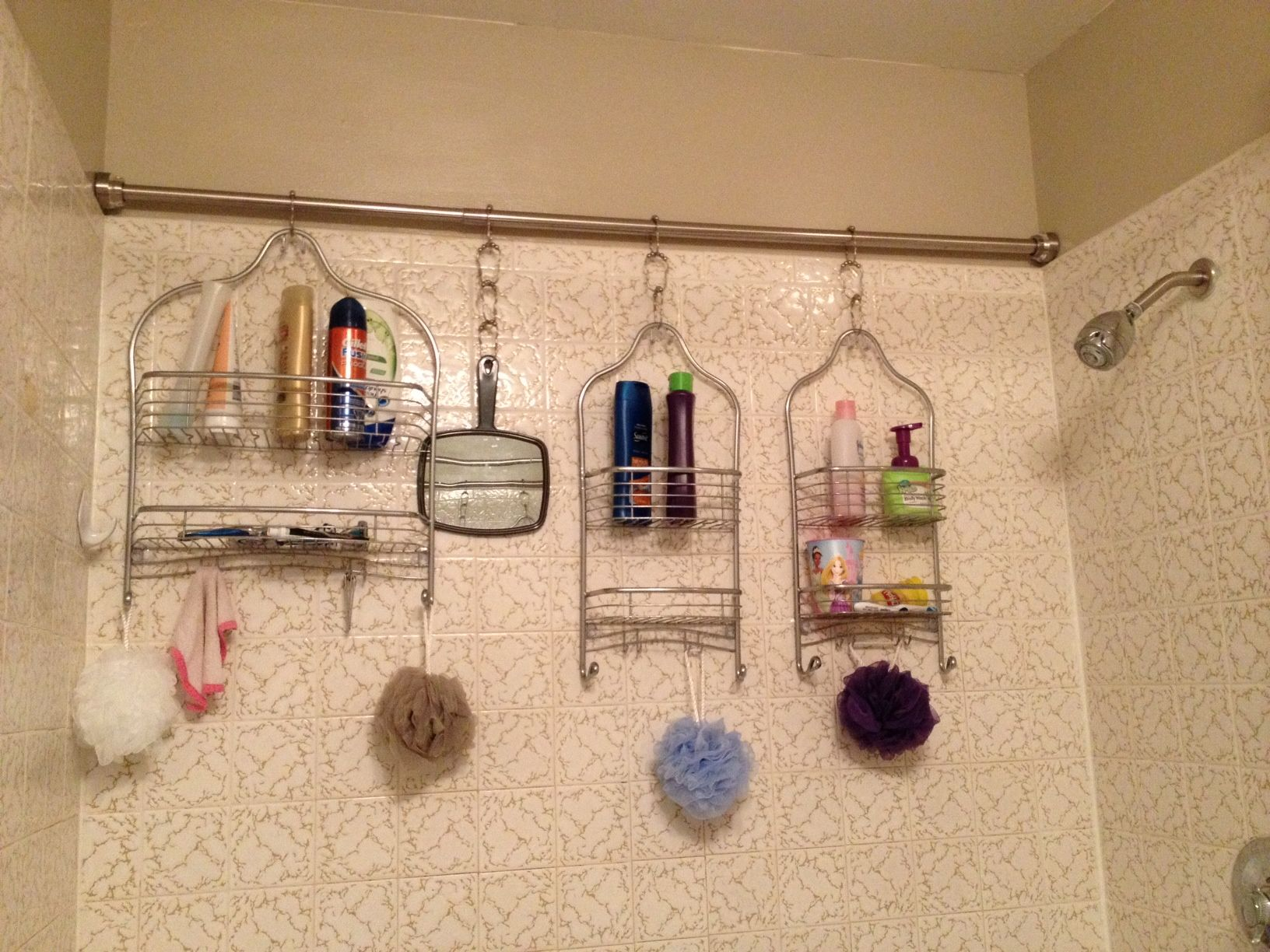 Install a tension rod in your shower and hang multiple shower caddies for additional storage.