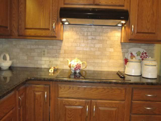 Chosing a backsplash with black granite counters ... on Backsplash Ideas For Black Granite Countertops And Cherry Cabinets  id=60367