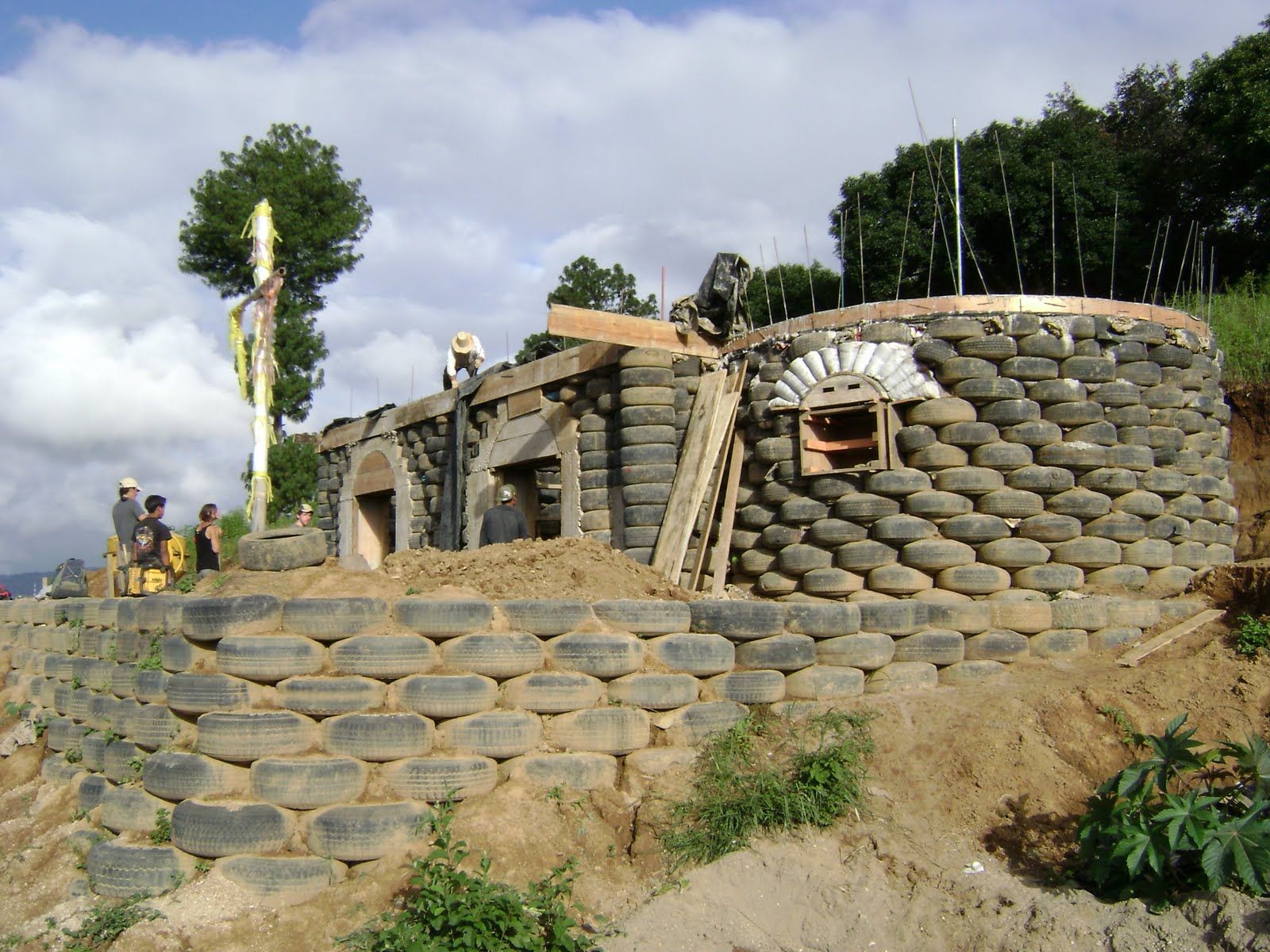 paxan school building 1 with tire retaining wall in on construction of walls id=42589