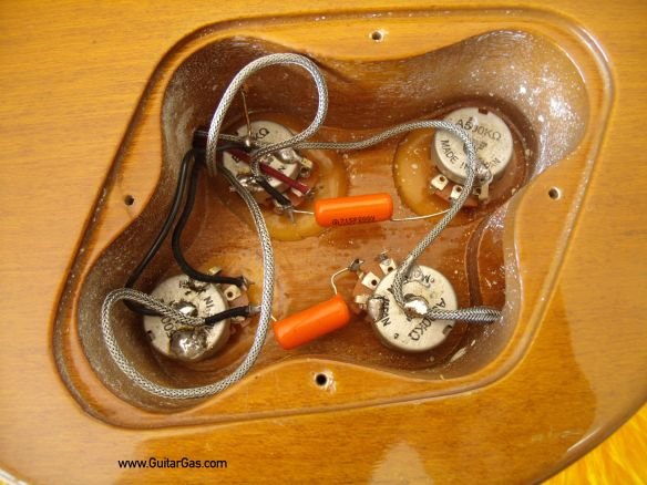 The 500k Gotoh pots in this Fernandes Super Grade Gold Top are wired up with 47nF Sprague Orange Drop capacitors