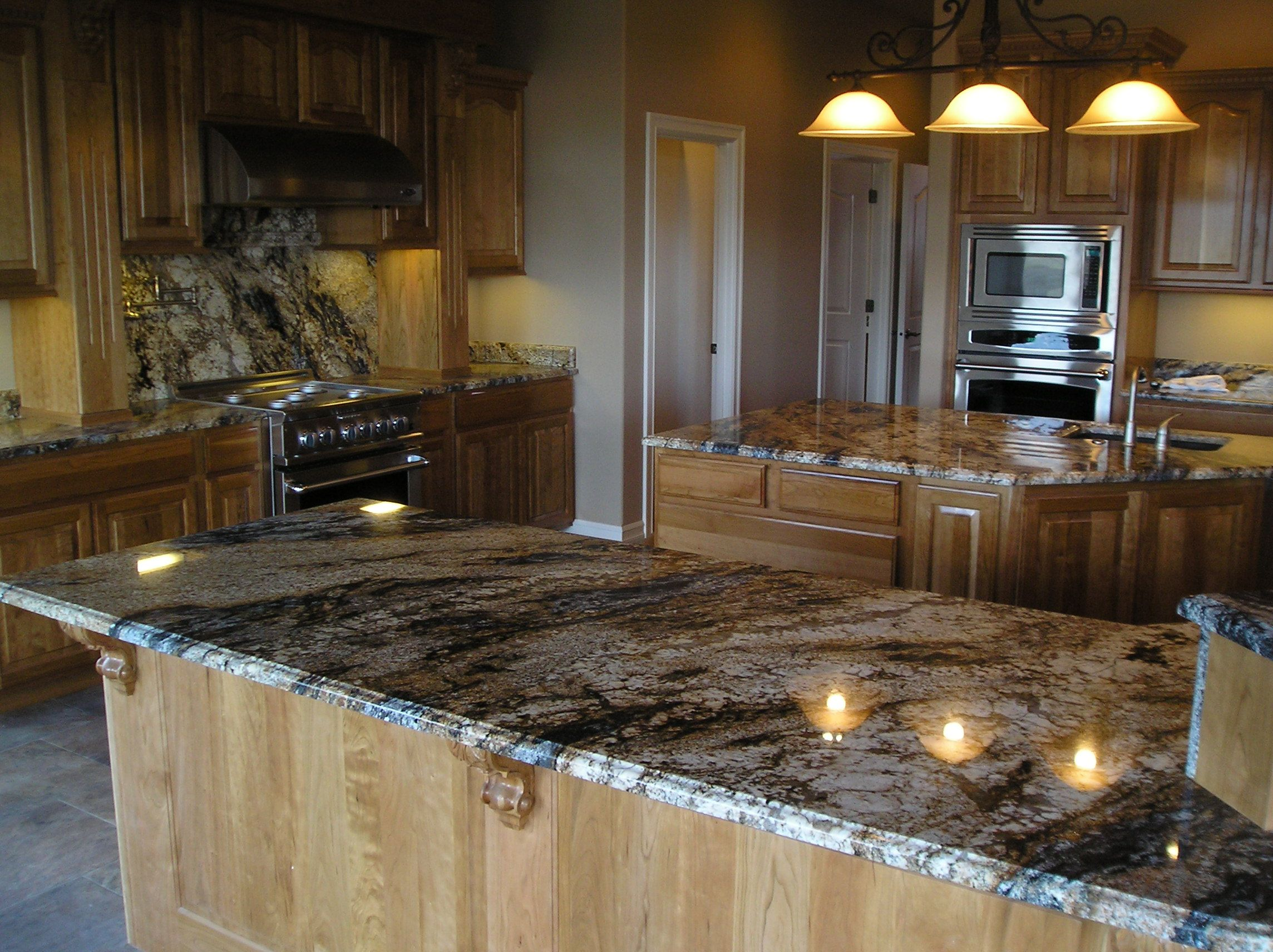 light maple cabinets with a granite that has a little blue ... on Backsplash For Maple Cabinets And Black Granite  id=19593