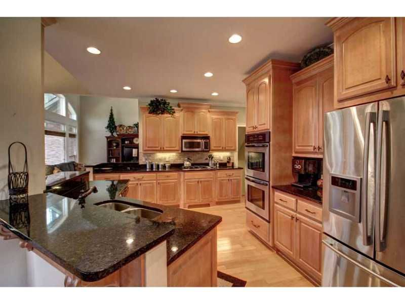 kitchen: stainless steel, dark granite counter tops, light ... on Natural Maple Cabinets With Black Granite Countertops  id=81149