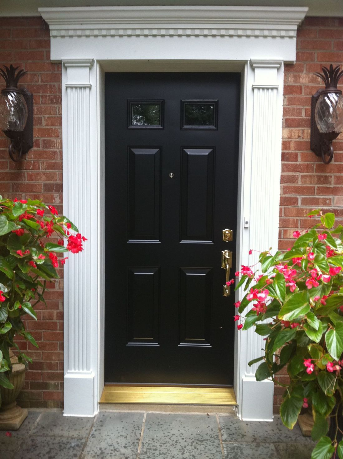 Amazing white classy paneled pilaster front door trim with