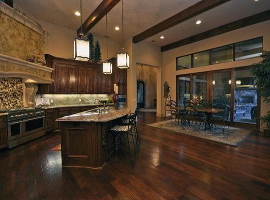 dark cabinets, dark hard wood floors, cedar beams on Maple Kitchen Cabinets With Dark Wood Floors Dark Countertops  id=26724