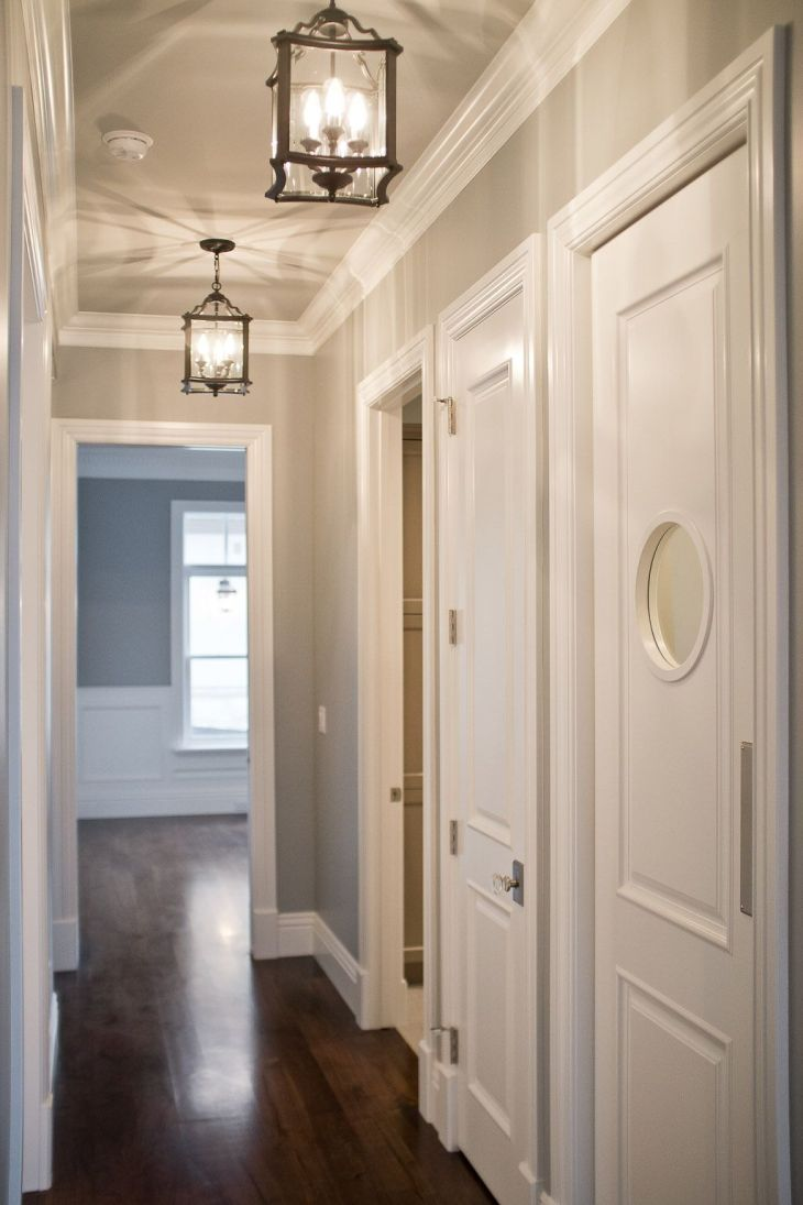 Grey walls and ceiling in same tone white woodwork Different tones