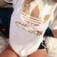 White adidas shirt with gold emblems white shirt with gold adidas