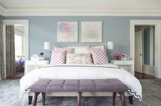Contemporary Bedroom Features A Pair Of Pastel Colored Abstracts Lining Blue Walls Over Crate