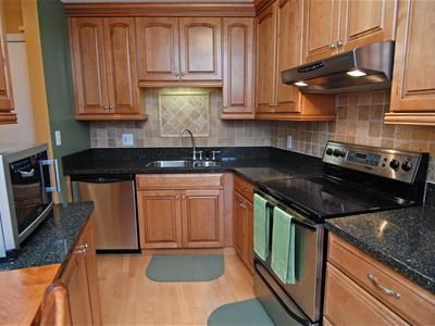 Or black granite with maple cabinets? | Building Our Home ... on Black Granite Countertops With Maple Cabinets  id=53819
