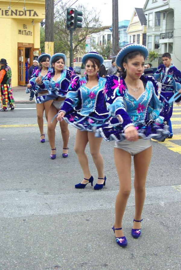 Caporales girls twirling around and flashing their silver ...