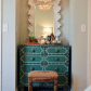 Neat design for the dresser like the mirror and the light fixture