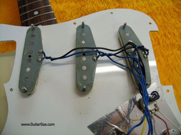 Under the hood of a Fernandes Stone logo Strat copy. Not sure if these Alnico pups are original but they sure sound good.