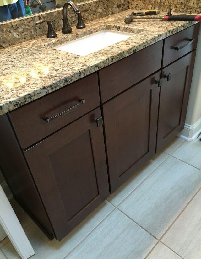 Elegant raised master bathroom vanity with cherry cabinets